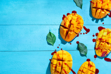 Mexican snack: Cutted tropical mango fruit with chilli
