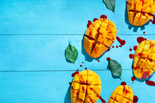 """Mexican snack: Cutted tropical mango fruit with chilli """"chamoy"""""""