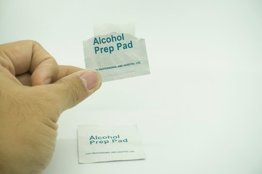 alcohol swab, isolated, used to sterilized skin area prior to injection or blood taking procedures