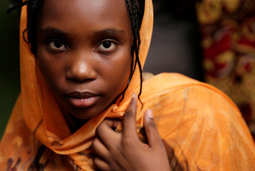 A Sudanese girl with braided hair is pictured in Cairo