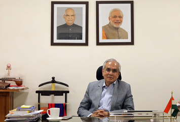 Rajiv Kumar, vice chairman of NITI Aayog, poses for a photograph inside his office in New Delhi