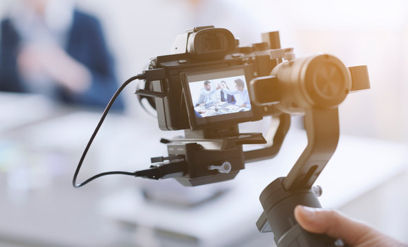 Professional videomaker shooting a video