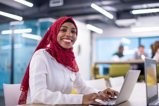 black muslim business woman ,working on laptop computer