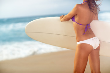 Attractive girl holding surfboard