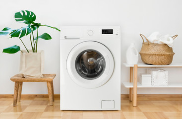 Clothes washing machine in laundry room interior Wall mural