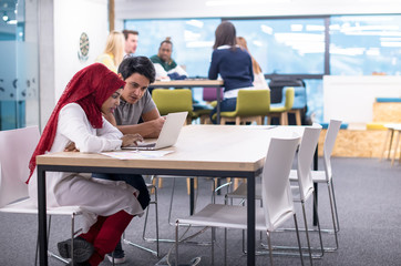 black muslim business woman having a meeting with her indian male colleague