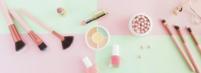 banner Makeup products, decorative cosmetics on pastel color pink mint background  flat lay.  Fashion and beauty concept. Top view. Copy space Wall mural