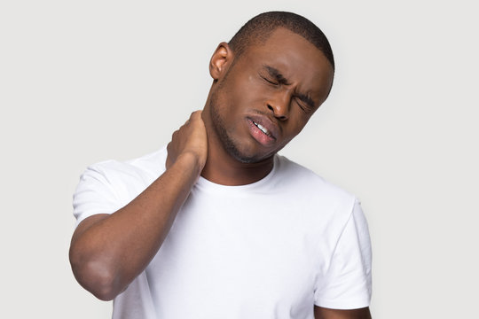 African man feels unhealthy closed his eyes for neck pain