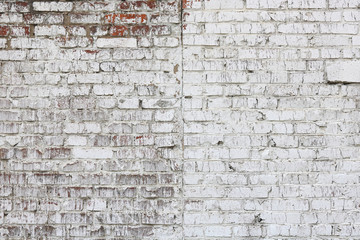 Old wall made of red brick, painted white in loft style for modern designer interior of room, bar...