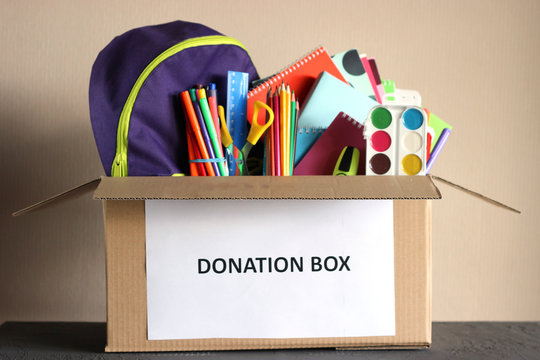 donation box with school stationery items