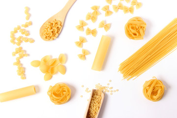 Different types of pasta on a white background top view.