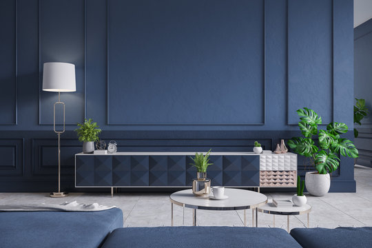 Modern interior of living room,blue Tv cabinet with  sofa , dark blue wall and Concrete Gray tile floor,3d rendering