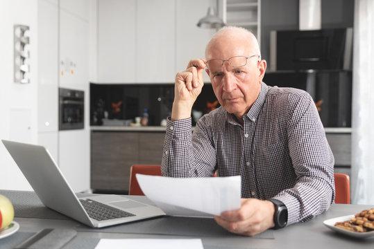 Senior man worried about bills and savings