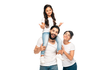 happy latin father carrying on shoulders cute daughter showing thumbs up near happy wife isolated on white