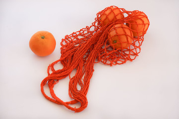 Handmade cotton reusable Orange string bag white background