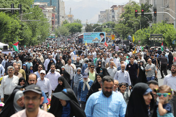 Iranians take part in a protest marking the annual al-Quds Day (Jerusalem Day) on the last Friday of the holy month of Ramadan in Tehran