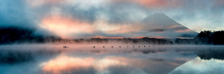 Foto op Canvas Donkergrijs Beautiful mystical sunrise at Lake Shōji with Mount Fuji as a backdrop and a row boat in the foreground