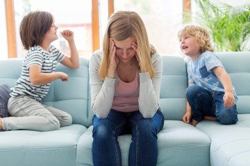 Frustrated mother with children
