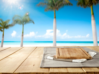 Table background of free space for your decoration and summer palms with sea