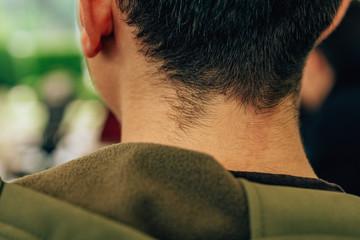 The guy in the khaki jacket. Walk around Tashkent city. Hood on clothes.