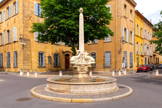 Aix-en-Provence. The square and the fountain of four dolphins on a sunny day.