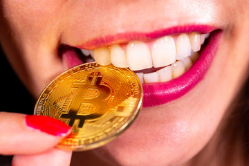 Bitcoin coin in woman's mouth