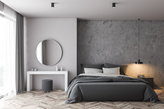 White and concrete bedroom with makeup table