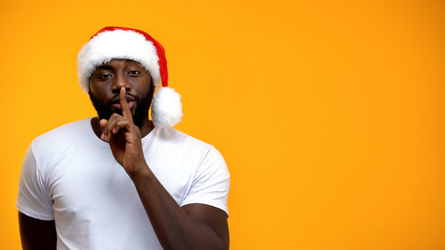 Afro-American Santa showing silence sign, Christmas holiday discount, template