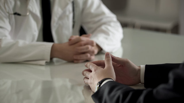 Person in suit at urologist appointment, private treatment of male diseases