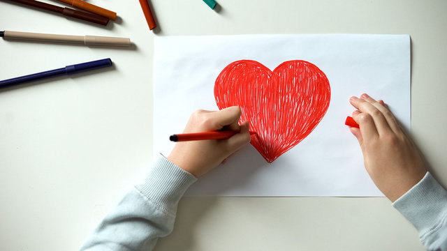Child painting big red heart, Saint Valentines Day gift, first love, childhood