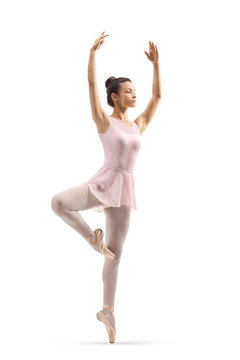 Beautiful young ballerina with arms up