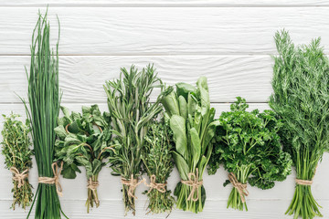 top view of various green herbs on white wooden table Wall mural