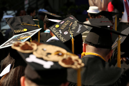 """An adorned graduation cap saying, """"USA and CHN"""" at The City College of New York commencement ceremony in Manhattan"""