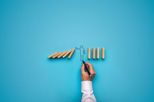 Handdrawn businessman stopping falling dominos