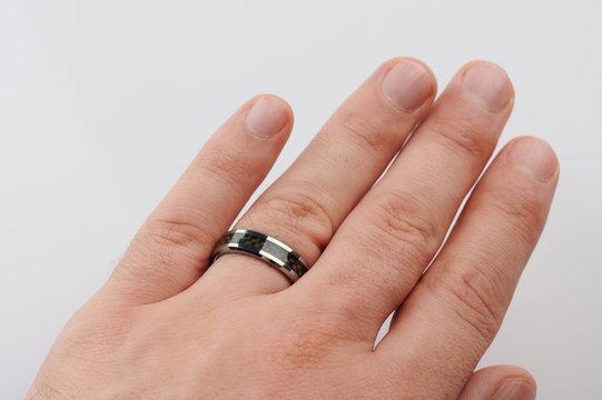 Black ring on man finger