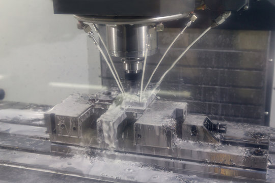 CNC milling machine cutting the metal injection mold part with the solid ball endmill tool. High precision manufacturing process