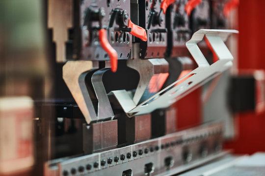 bending machine at work. process of metal sheet forming