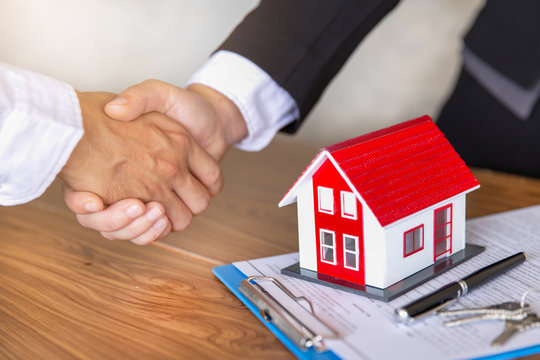 Estate agent shaking hands with customer after contract signature, Business Signing a Contract Buy - sell house, Home for rent concept.