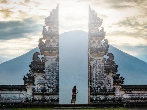 Bali, Indonesia, Traveler Standing at the Ancient Gates of Pura Lempuyang Temple aka Gates of Heaven