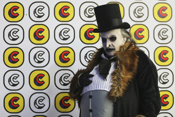 An attendee, dressed as Penguin from Batman movie, poses for photographs during Comic Con Colombia in Bogota