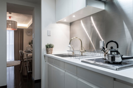 Small stainless steel kitchen set in a small apartment