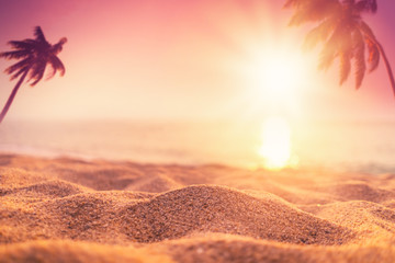 Blur beautiful nature green palm leaf on tropical beach with bokeh sun light wave abstract...