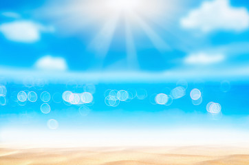 Wall Mural - Blur tropical beach with bokeh sun light wave abstract background.