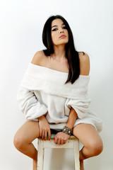 portrait of sensual latin girl in photo studio