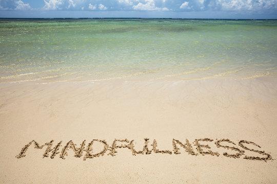 Mindfulness Written Text On Sand At Beach