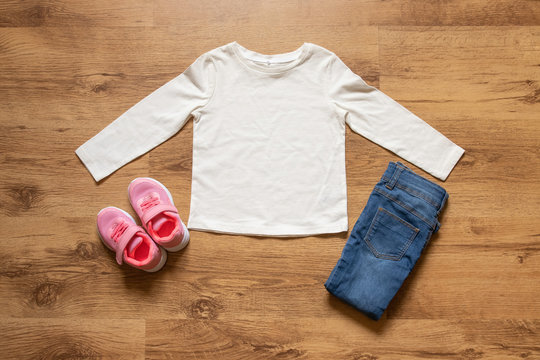Blank white toddler girl long sleeved t-shirt with sneakers/trainers and jeans props -  kid's apparel mock up