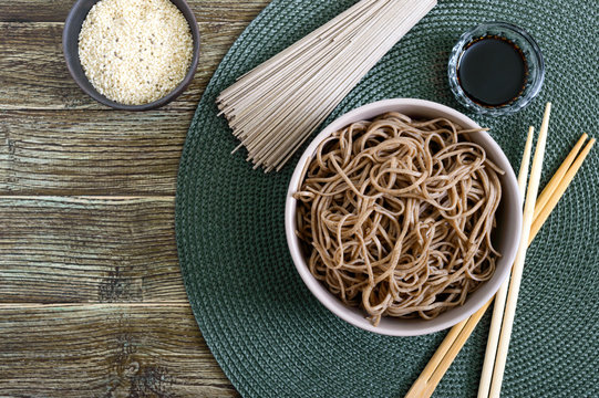 Cold soba (buckwheat noodles) with sauce and sesame. Japanese food. Traditional asian cuisine - noodles from buckwheat flour. Top view, flat lay.