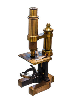 Vintage brass microscope isolated on white background. A monocular microscope from the 19th century.