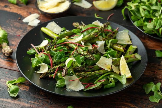 Grilled Asparagus salad with green vegetables and parmesan cheese