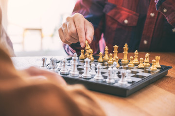 Closeup image of a man moving and playing chessboard game together